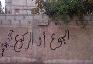 """""""Beugt euch oder sterbt vor Hunger"""" ist einer der Slogans, den Bewaffnete bereits in anderen Städten an den Zugängen zu belagerten Ortschaften an die Wände geschrieben haben."""